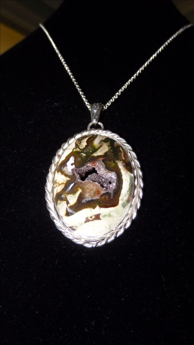 NUNDLE PRASE with druzy quartz centre, in sterling silver bezel and chain.