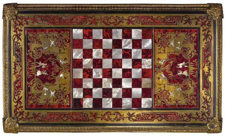"""A George IV gilt-bronze mounted contre-partie cut brass inlaid and red tortoiseshell games table attributed to Thomas Parker, second quarter 19th century the top with a chessboard of parquetry mother-of-pearl and tortoiseshell and possibly including Louis XIV """"Boulle"""" marquetry panels, above a frieze drawer to the shaped apron and on cabriole legs ending in hoof sabot"""