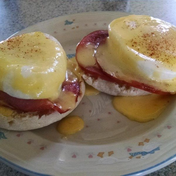 This is a no-fuss, easy recipe. The Hollandaise sauce is simply put together in a blender - no double boiling necessary. Serve the eggs with sauce on hot buttered English muffins or toast. Yum!