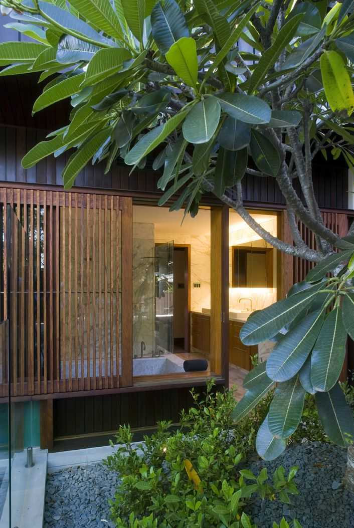 Samford House: View from courtyard showing timber privacy screening. See more at http://blighgraham.com.au/projects/samford-house-1