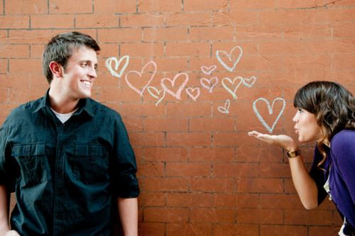 chalk on a wall in background- this would be a cute engagement photo!