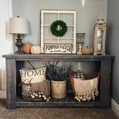 Like this grouping for top of cabinet under the stairs