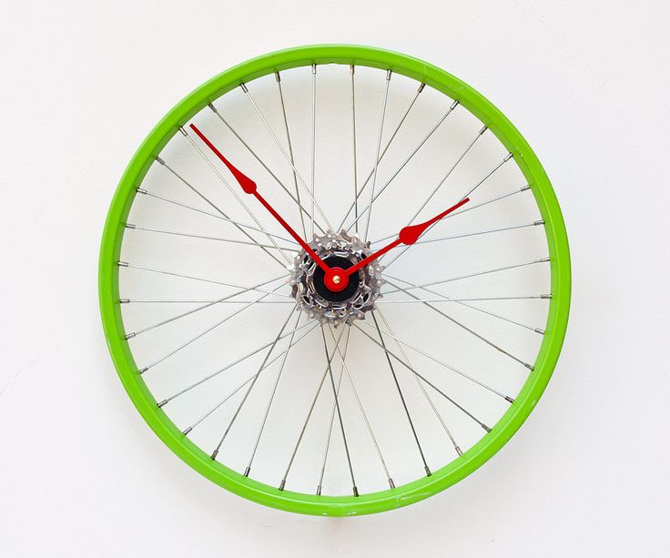 This clock was created from a recycled steel bike wheel. The wheel mounts directly to the wall through the hub using a hollow wall anchor and gives the illusion that it is floating off the wall. The clock movement is a high torque German quartz movement and is attached to a set of rear cassette gears to conceal the movement.The clock runs on 1AA battery, included. his wheel measures roughly 16 inches in diameter. these clocks are made from actual recycled bike wheels there will be…