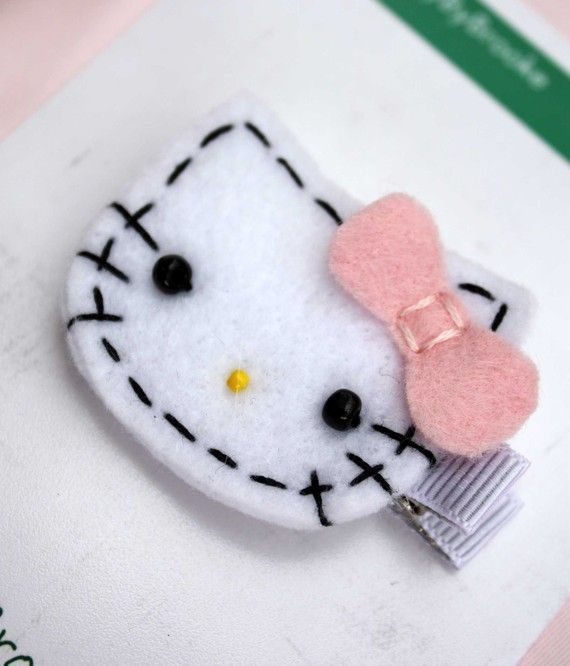 (Felt Hello Kitty Hair Clip by BabyByBrooke on Etsy, $4.50)...Britney! Craft nite!
