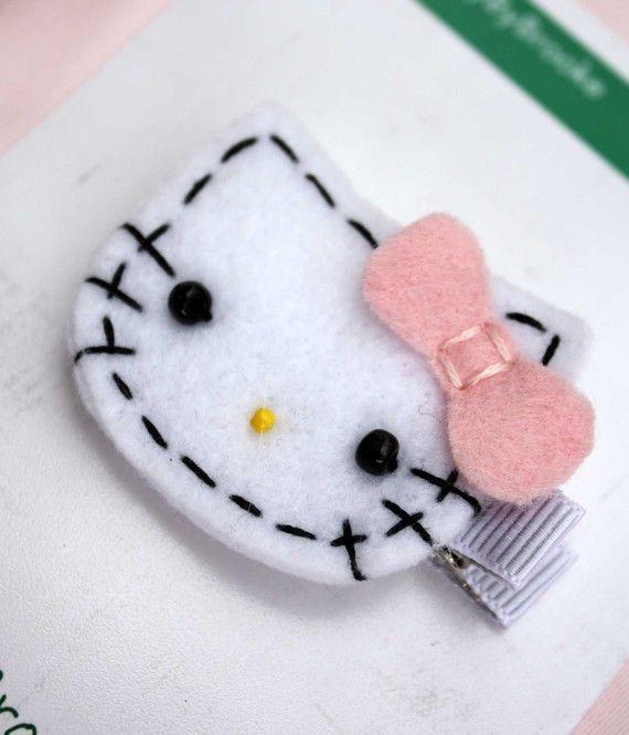 (Felt Hello Kitty Hair Clip by BabyByBrooke on Etsy, $4.50)...Britney! Craft nite!