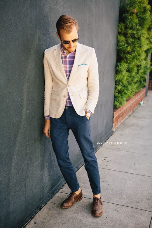Shop this look for $230:  http://lookastic.com/men/looks/blazer-and-longsleeve-shirt-and-pocket-square-and-chinos-and-oxford-shoes/1564  — Beige Blazer  — Violet Plaid Longsleeve Shirt  — Light Blue Pocket Square  — Navy Chinos  — Brown Leather Oxford Shoes