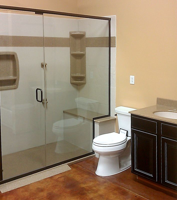Nice walk in shower with bench seat and accent color used around the