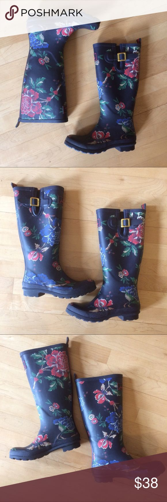 "Most adorable floral wellies cutest navy blue pull slip on style rain boots. Matte Navy blue with bright floral print-red, & blue peony floral w/ green leaves. Functioning buckle on the top allows for wide calf. Interior blue + red stripe, pulling away a bit, + light scratching but does not affect function. Good used condtion, with LOTS of life left. Selling bc I purchased a new pair of rainboots. Perfect pop of fun for a dreary rainy day! UK4 US6 EURO37 1.25"" heel, 13"" shaft, 16""…"
