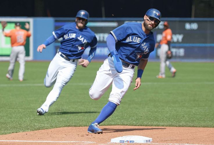 Race around the bases - Kevin Pillar of the Toronto Blue Jays races home to score as Josh Donaldson runs to third base right behind him against the Baltimore Orioles on Sept. 5 in Toronto. The Blue Jays won 5-1. - © Tom Szczerbowski/Getty Images