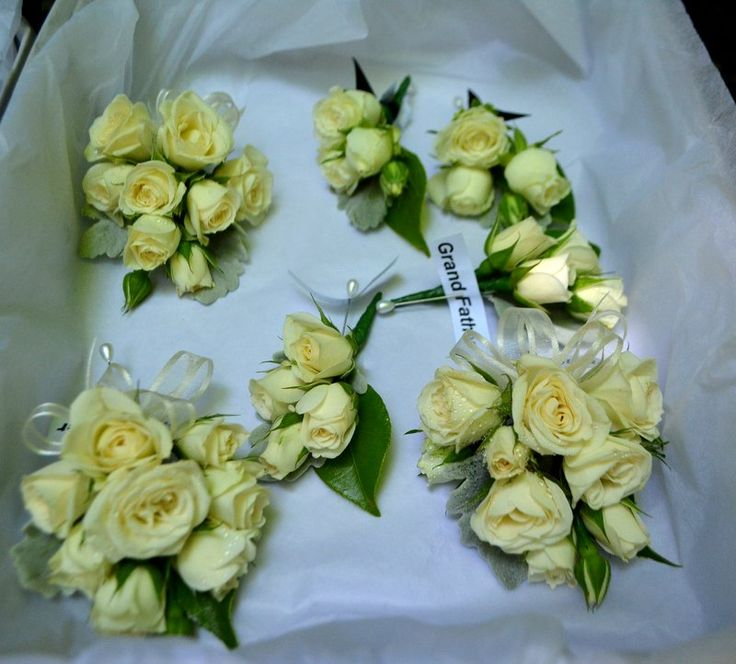 The Corsages are buttonholes are tiny Ivory spray roses with silver and green leaves. by I do flowers