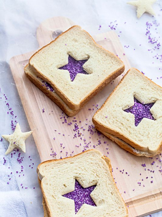 """Make anyday a celebration! Just barely sweet, these sparkly sandwiches make a fun breakfast surprise, after-school snack, or party food. Inspired by Robert Louis Stevenson's poem """"Fairy Bread"""" in …"""