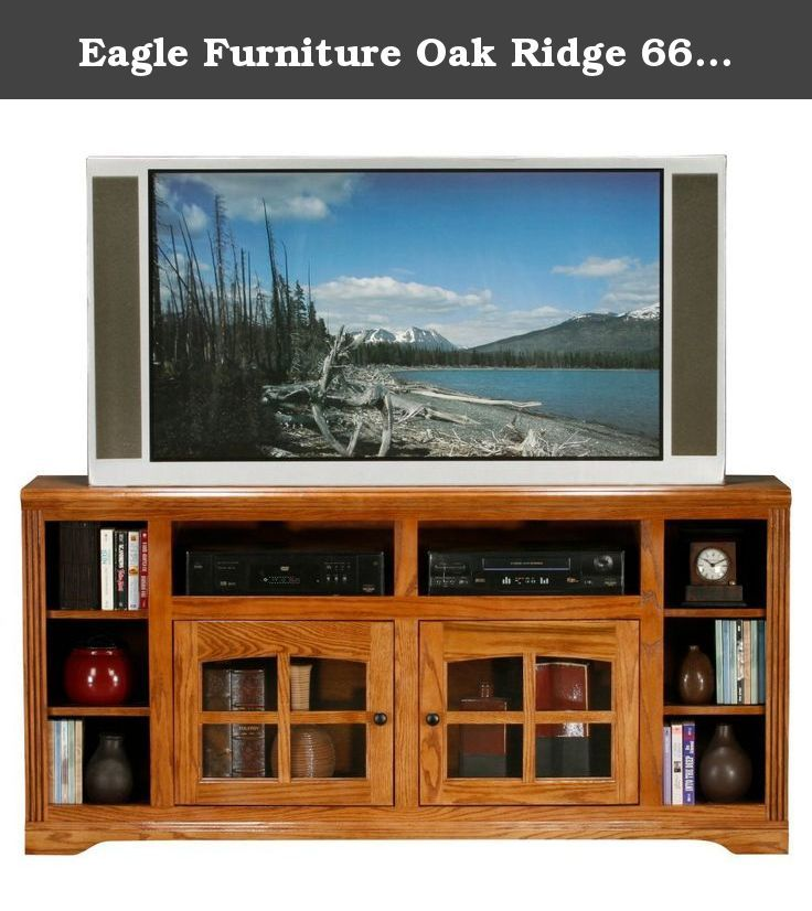 Eagle Furniture Oak Ridge 66 in. Thin TV Stand. Create a place for style and entertainment with the Eagle Furniture Oak Ridge 66 in. Thin TV Stand. Made with sturdy wood and veneer, this piece features plenty of shelf room for display of decorative items and video components. Its glass panel doors add transitional appeal and open to reveal even more storage. Ideal for up to a 73-inch flat panel screen. Additional Features:Decorative molding Cable management 4 fixed wood shelves 2 glass…