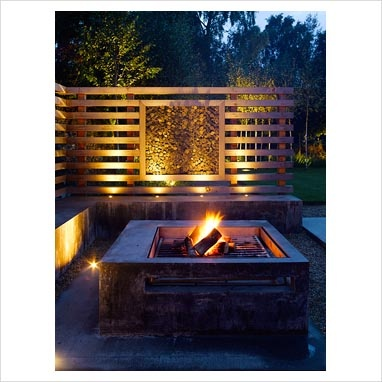 Minimal garden lit up at night - nice fire pit, braais as well and nice lighting as a bonus in background. Good idea to perhaps have those concrete seating as well