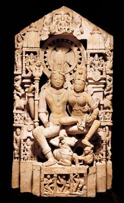 The gods Shiva and Pārvatī appear in South Asian sculpture in several iconographic forms and incarnations. In this form, Shiva appears as Maheshvara, or the Great God, and Pārvatī as Uma, the daughter of Himavan, the King of Mountains. In her incarnation as Uma, the goddess performed many meritorious deeds in order to marry Shiva. Together, Uma and Maheshvara represent an ideal married couple with arms draped around each other. Their two sons, Ganesha and Skanda, stand beneath them on either…