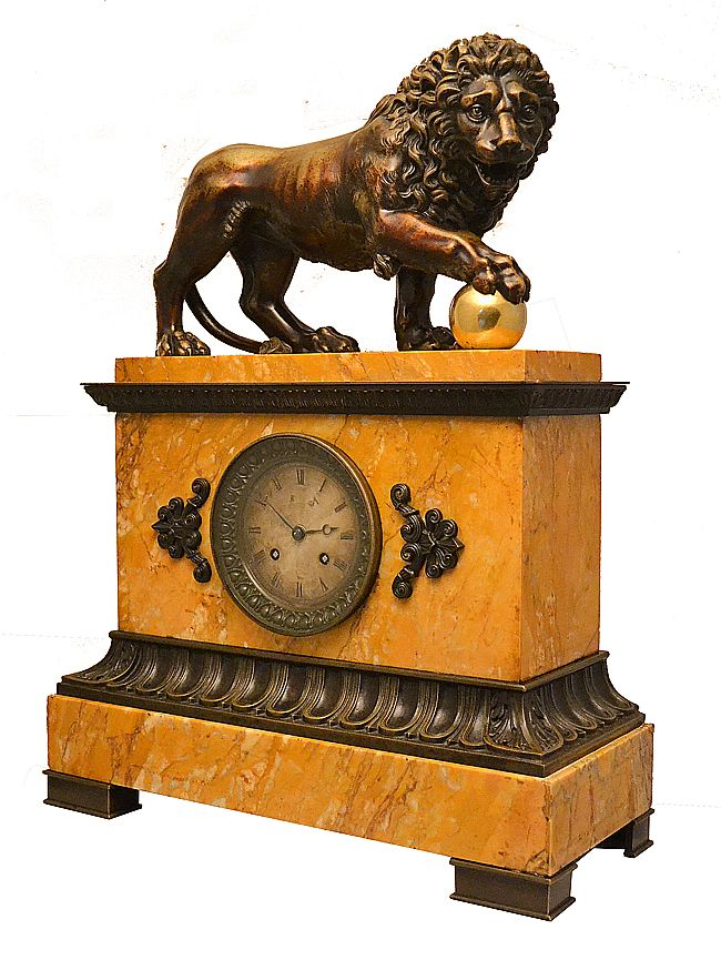 Imposing lion #clock in patinated #bronze and #Siena #marble. on the top a magnificent lion and a finely chiseled gilt bronze ball. Restauration, circa #1830. For sale on Proantic by Clock Prestige.