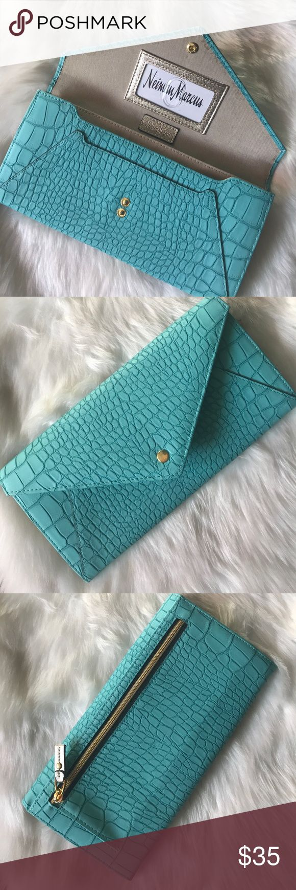 "EUC. Neiman Marcus Croc Embossed Envelope Clutch EUC. Neiman Marcus Croc Embossed Envelope Clutch in Turquoise and Gold faux leather. Excellent used condition. Only used once for a wedding. Lots of room in this clutch. Exterior zipper pocket. Four inside slip pockets, 8 credit card slots and an id slot. Fits even the largest phone!  Approx. 9.5 x 5 x 1"" Neiman Marcus Bags Clutches & Wristlets"