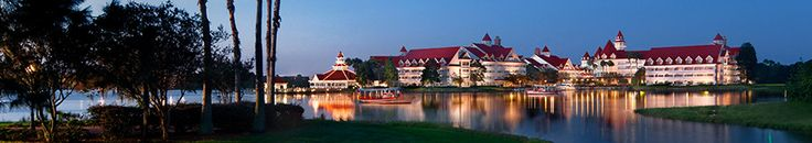 Disney's Grand Floridian Resort & Spa at night as seen from a grassy area across Seven Seas Lagoon