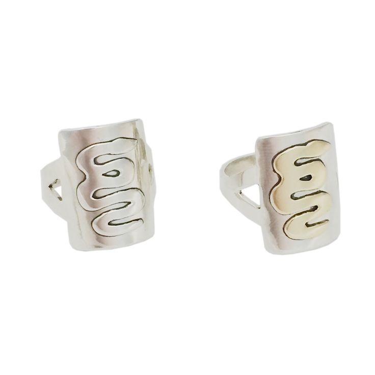 Handmade in sterling silver with a sterling silver or brass meandering serpent design.