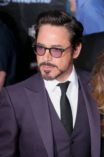 "Robert Downey Jr. wearing an amethyst-colored Gucci suit and matching sunglasses at the ""Avengers"" world premiere in Hollywood.  Purple is his favorite color.  (This outfit has been dubbed ""the purple suit of sex"" by the fandom...!)"