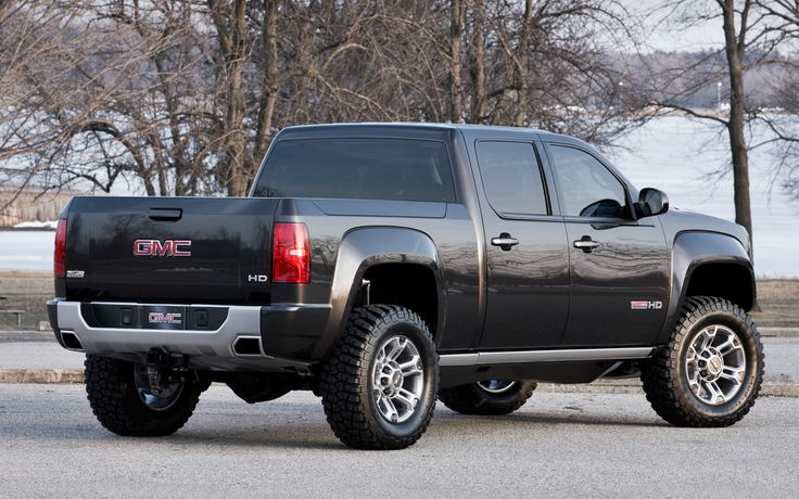 Black lifted GMC Sierra truck