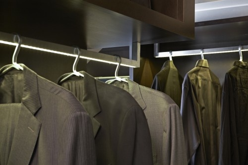 The hanger rod has a strip of LEDs at the bottom. Easier to see what the clothes are. Smart idea!
