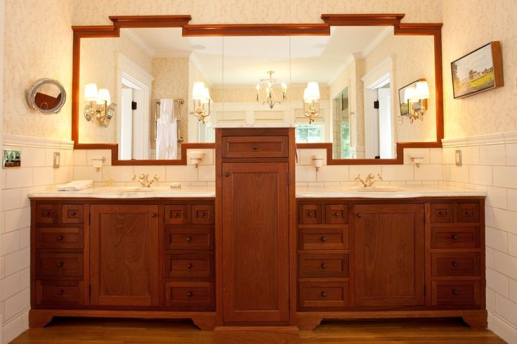 Cabinetry by Black Bear Woodworking & Fine Cabinetry www.blackbearcabinetry.com Mahogany vanity Carrera Marble countertop Mahogany framed mirror