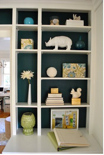 Back painted bookshelves are always an unexpected surprise and they make all the difference! This is a design trick that pops your stuff and makes it interesting...try it, you won't regret it!