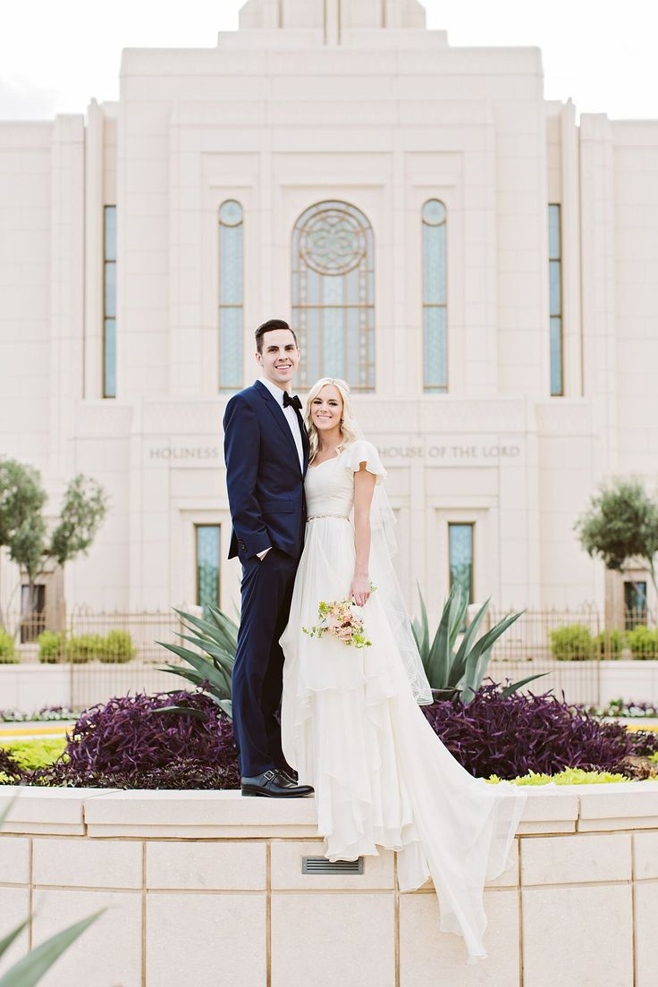 modest wedding dress with flutter sleeves and a flowing skirt from ...