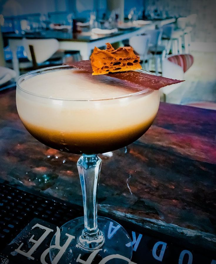 Cocktail of the Day: salted caramel espresso martini . Glass - short coupette . Ingredients - 20ml stoli vodka - 10ml stoli salted caramel vodka - 30 ml Kaluha - 30ml fresh espresso coffee - 10ml agave syrup - small pitch of salt . Method - combine all shake hard double strain . Garnish - homemade thin chocolate fudge wafer with gold dust - homemade honey comb chunk - bottom of the glass drop 4 caramel coffee pearls for a final burst of flavour.  Bartender - Aaron Goodfellow . Bar…