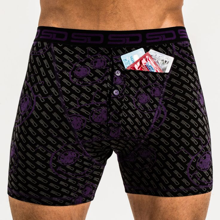 Fantazia Smuggling Duds Boxer Briefs. Smuggling Duds joins forces with legendary dance record label Fantazia. This design uses the iconic Fantazia smiley face logo in purple with grey SD pattern and purple thread trim and buttons. All Smuggling Duds boxer shorts have the design registered stash pocket.