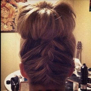 How to: Flip head upside down and french braid about 2/3 of the way up, then tie all hair into a ponytail/bun/braided bun.