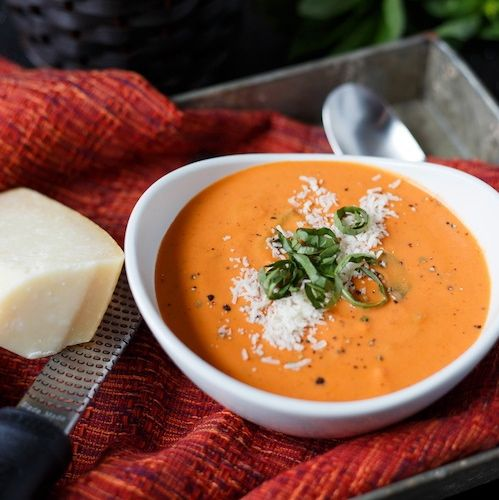 Easy tomato basil soup...I would probably add some gnocci to it too. And cook it all in the crockpot.