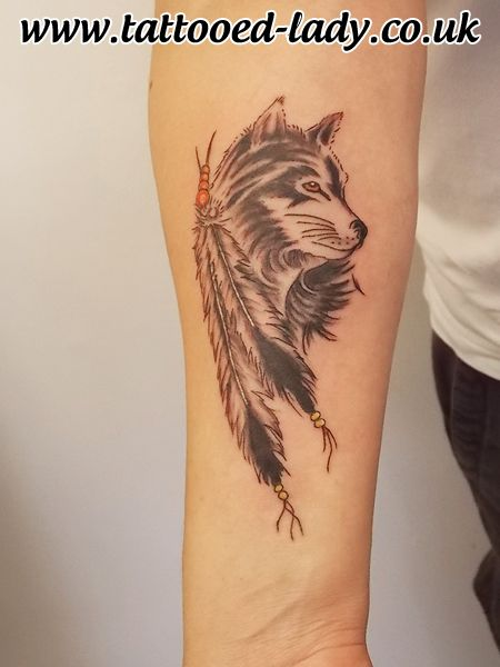 Wolf and feathers tattoo in native american style by for Wolf tattoo with feathers