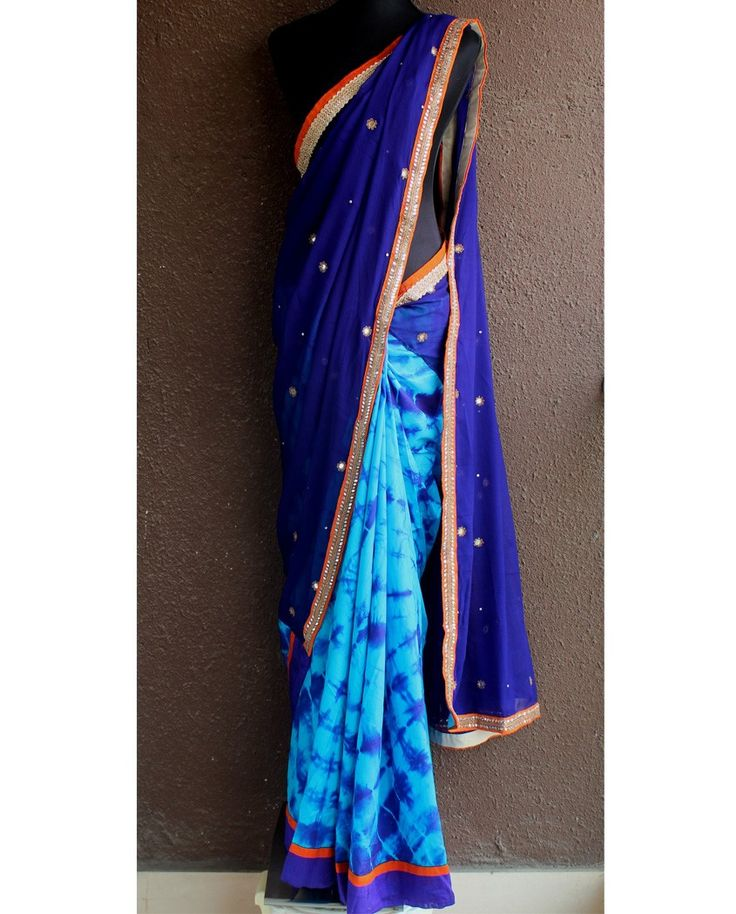 Purple and blue sari with embellished border   1. Purple and blue chiffon embroidered saree2. Purple pure chiffon pallu with mirror-beads highlight and turquoise-purple tie n dye satin silk pleats. The border is of mirror work with orange accent3. Comes with stitched blouse