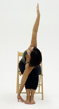 10 Yoga Poses You Can Do in a Chair: Chair Extended Side Angle - Utthita Parsvakonasana