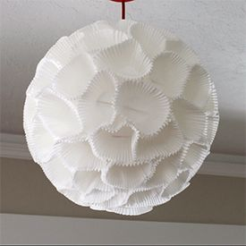 paper lamp shade. i like this design as i think it is fun and i also like the idea of using the muffin casings to create the shade. furthermore i like the shape a i think it looks nice and really appealing