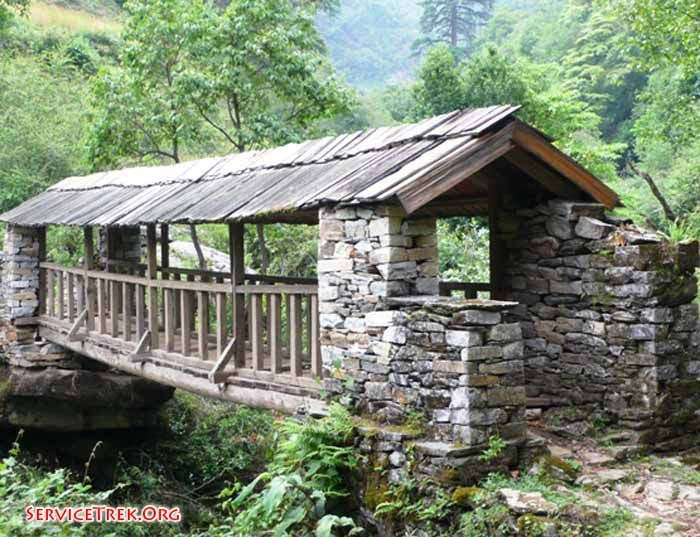 Covered bridge in Nepal.  Volunteer Nepal charity non profit Service walks and projects Spring 2011