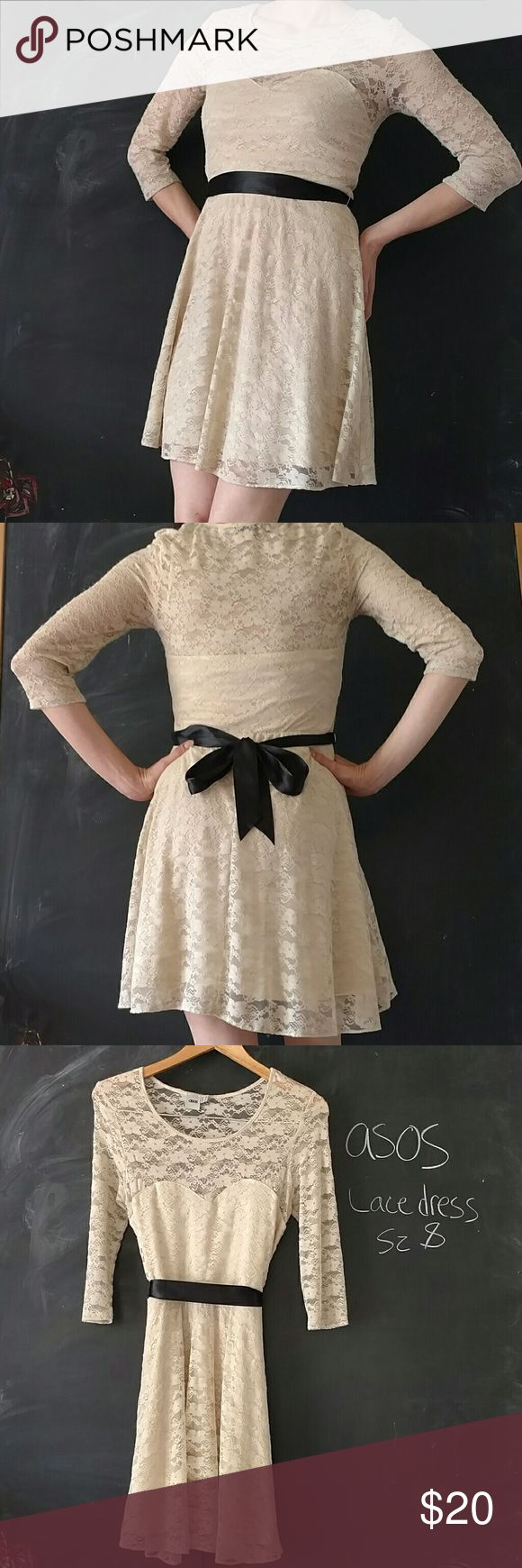 Asos Lace Dress Sz 8 Beige wirh Black Ribbon Belt Asos Lace Dress.  Sz 8 Bust 34-36 in. Length of skirt from top of waist to hem is 18.5 in.  Above knee. Waist 26-32 in. 3/4 sleeves.  Beige lace dress with stretch.  Good used condition with some signs of wear where lace is more fuzzy.  See last two pics.   Black ribbon tie belt.  No stains or tears.  Still very adorable dress.  Lace is comfortable and not itchy.  Lined.  Smoke and Pet free environment.  No trades. ASOS Dresses