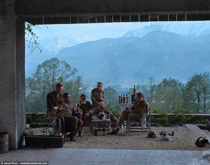 Members of the USA's Easy company celebrate VE Day (May 8, 1945) in Adolf Hitler's Berchtesgaden residence in Austria. After a short bombing campaign of the town of Obersalzberg, where the house was located,  troops seized the residence.  Easy company want onto inspire the multi-award winning series Band of Brothers. Left to right: Major Richard Winters, Captain Lewis Nixon, First Lieutenant Harry Welsh, First Lieutenant Thomas Peacock. Enos could not identity the soldier on the far right.