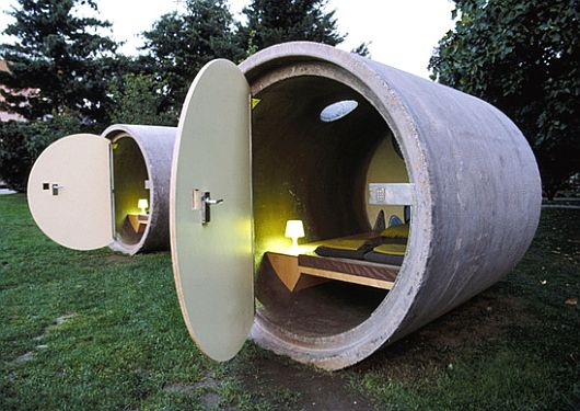 """Now all you have to do is to make sure your two """"shelters"""" are waterproof, dig a hole about 12 feet deep, and lower them into the ground so that you have an underground bunker network. You already have a hole at the top of your """"shelters"""" that can be used for ventilation. The result: storm proof, waterproof, and relatively tamper proof underground bunkers."""