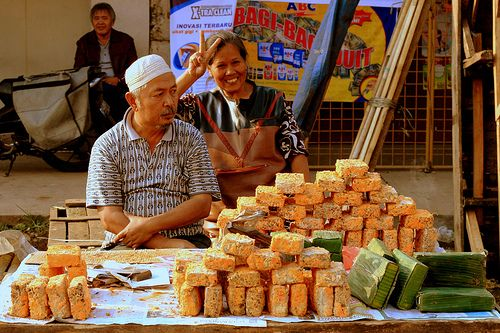 Indonesian Traditional Market: Oncom Seller.Location: Andir Traditional Market, Bandung, Indonesia