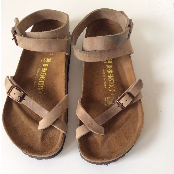 Leather, only wore them once. Size 38, brown leather sandal. Comes with the original shoe box.