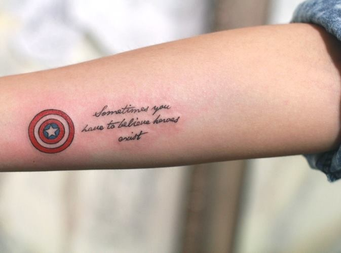 "that's my tattoo. script says ""sometimes you have to believe heroes exist"", a belief i met during this stage of my life and i'll never wanna forget it. remind myself i'm never alone to face the difficulties. Your superhero will come to your rescue just when you need them the most. inked at justice ink, taipei."
