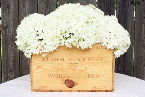 Turn an old wine crate into a blossoming centerpiece, with the help of hydrangeas and a collection of glass jars. Place taller containers in the middle to give the arrangement more oomph. Get the tutorial from Design, Dining, and Diapers »