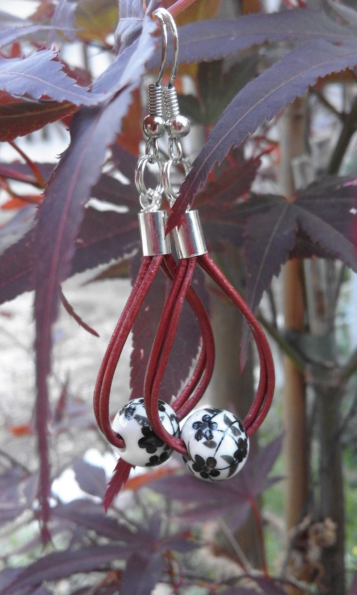 2 claret leather threads with a black florid bead.