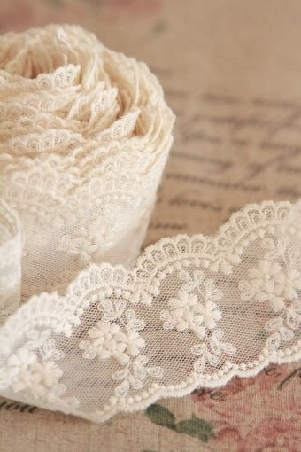 embroidered scallop edge lace trim that is rolled makes lovely layered lace roses