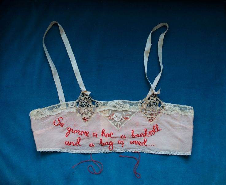 Zoe Buckman's hand-embroidered Biggie and Tupac lyrics which reference women onto a dazzling array of vintage slips, bras, and undergarments.