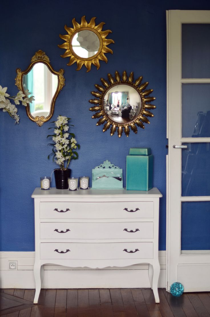 mirrors on a royal blue wall living room pinterest