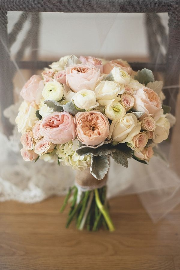 Sweet wedding bouquet with garden roses and ranunculus
