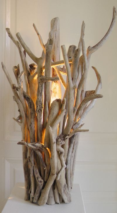 Gorgeous twig and branch light fixture, perfect for an eclectic living room. Treibholz Elke Paus
